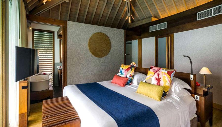 Bedroom of overwater bungalow at InterContinental Bora Bora Thalasso Resort