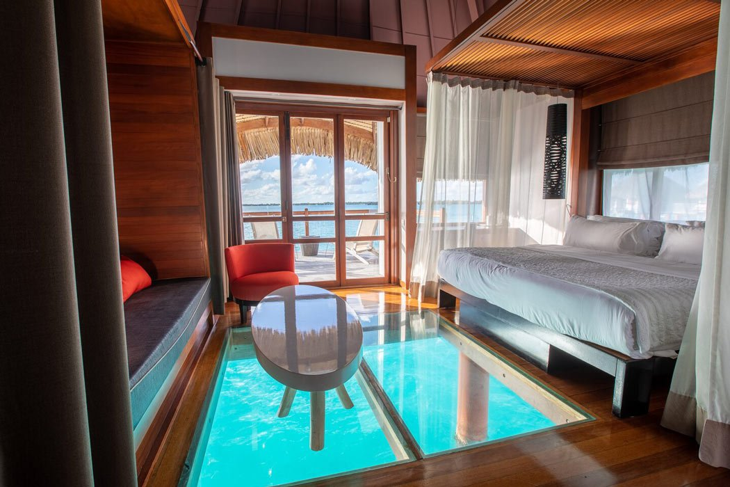 Overwater bungalow at Le Meridien Bora Bora with glass floor