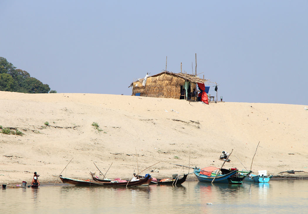 A shack on the riverbank that will be washed away in rainy season
