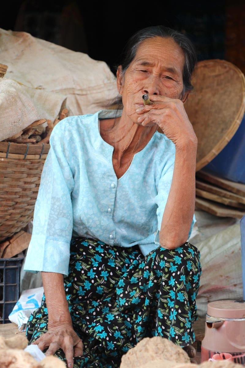 Woman smoking a cheroot in Myanmar