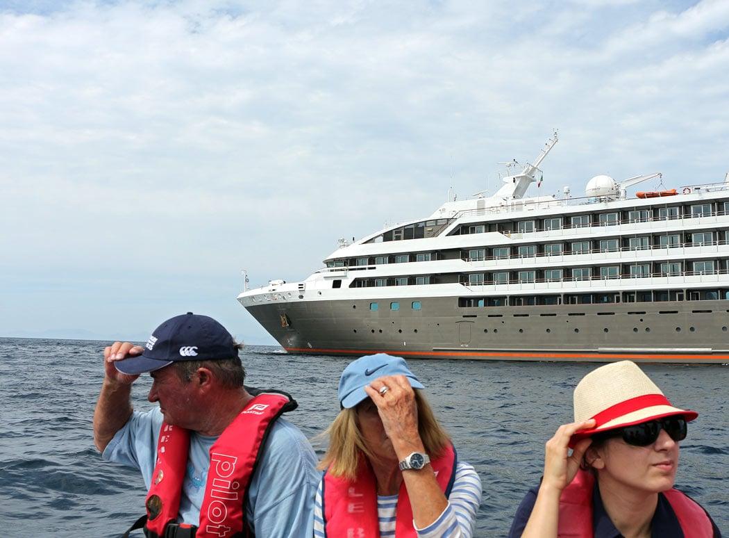 Guests depart Le Boreal on a Zodiac for a shore excursion
