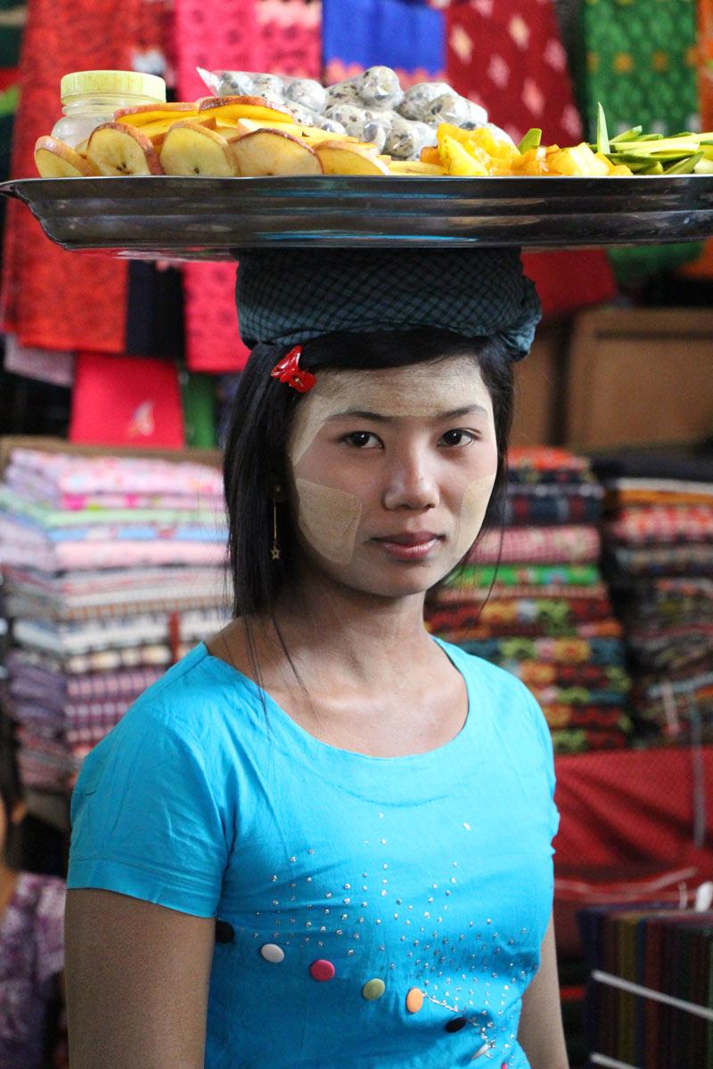 Myanmar girl with fruit on her head