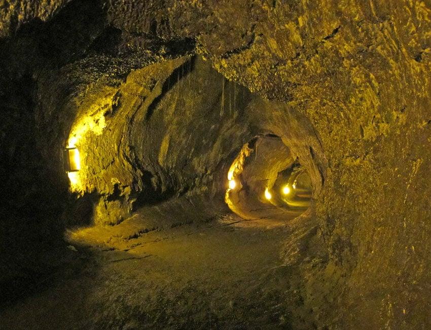 Walking through the Thurston lava tube in Volcanoes National Park feels like you're inside the belly of a prehistoric monster