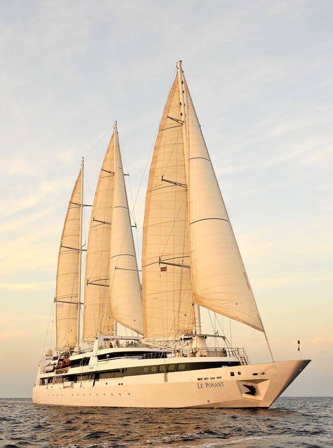 Le Ponant sailing into the sunset