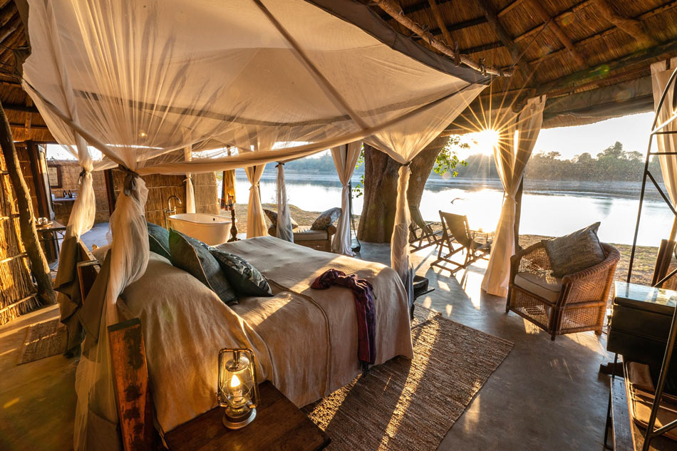 Mchenja Bush Camp has five bush-chic tented chalets overlooking the Luangwa River.