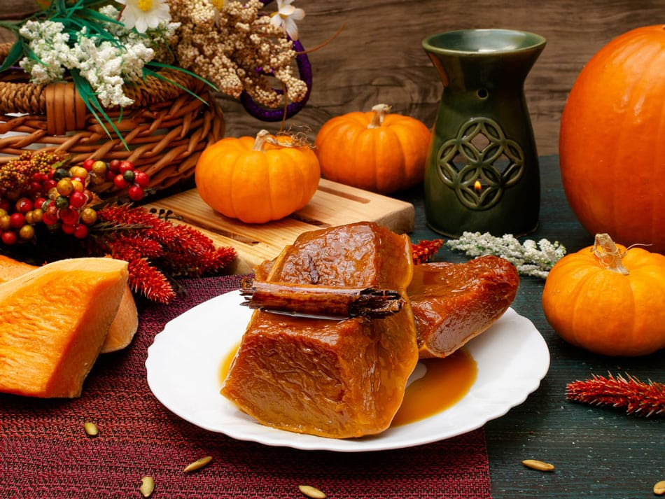 Calabaza tacha (pumpkin cooked and soaked in a sweet caramel sauce) is a traditional Mexican dessert for Day of the Dead.