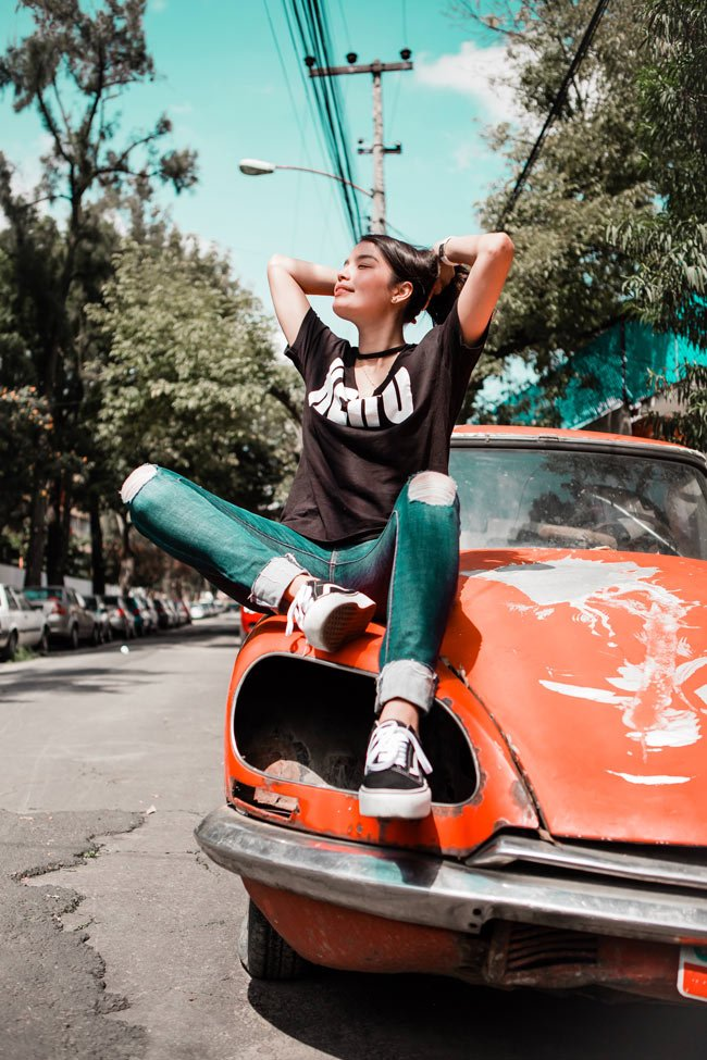 Girl sitting on a car in Mexico City