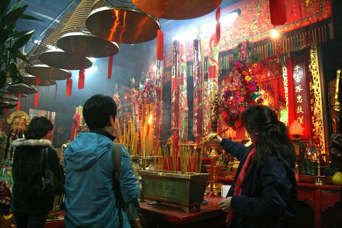 Devotees burn incense inside the Kwan Tai Temple in Hong Kong.