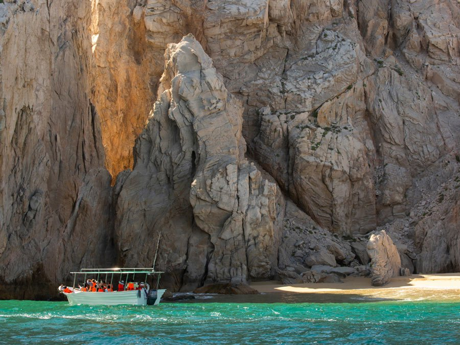 Water taxis are the easy way to reach Lover's Beach in Cabo San Lucas.