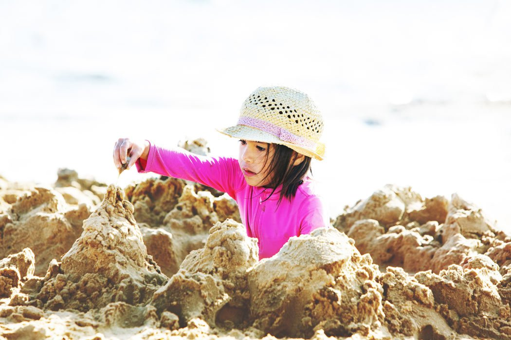 Child playing in the sand at Anini Beach