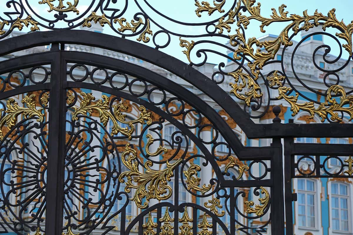 What lies behind this entrance gate to Catherine Palace, St. Petersburg? Glitz, gold and a monumental mystery.