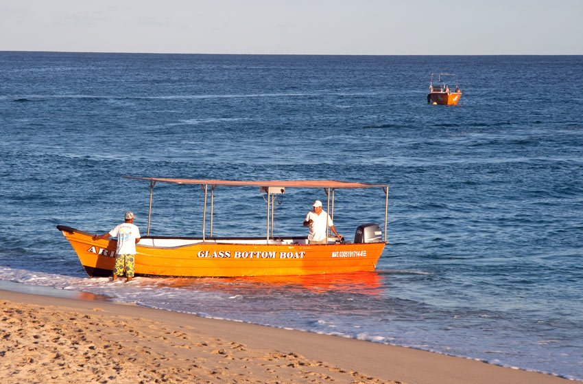 Glass bottom boats take passengers from Medano Beach to Land's End.