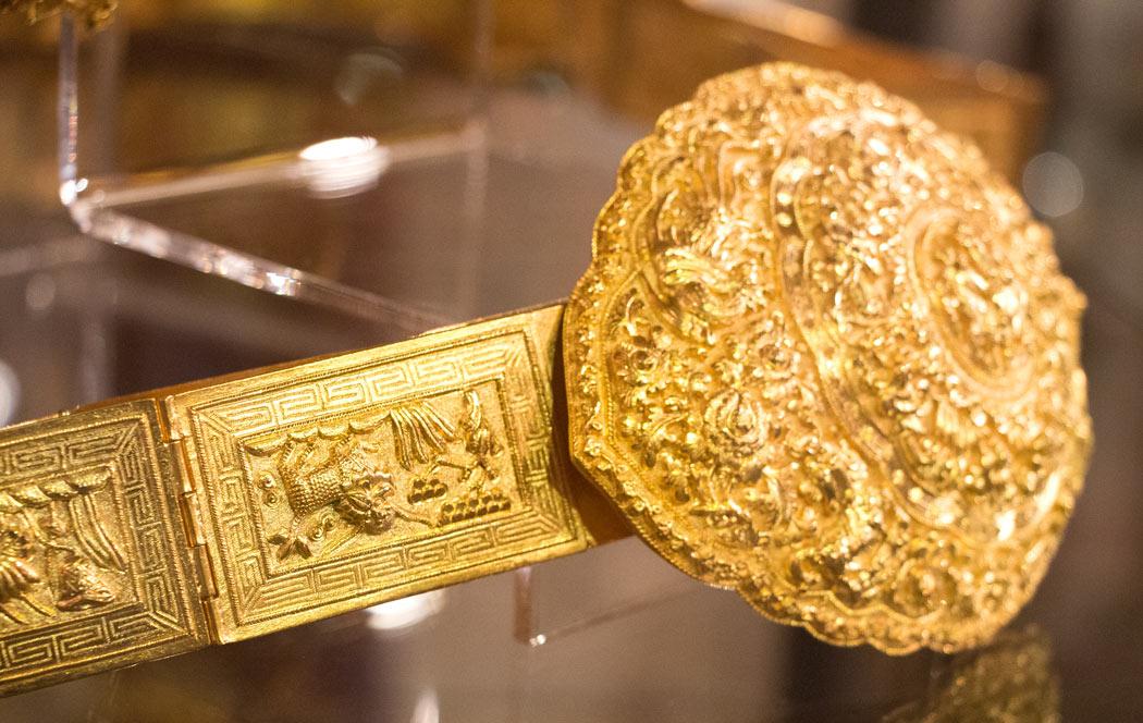 A large gold Peranakan belt on display at the Pinang Peranakan Museum