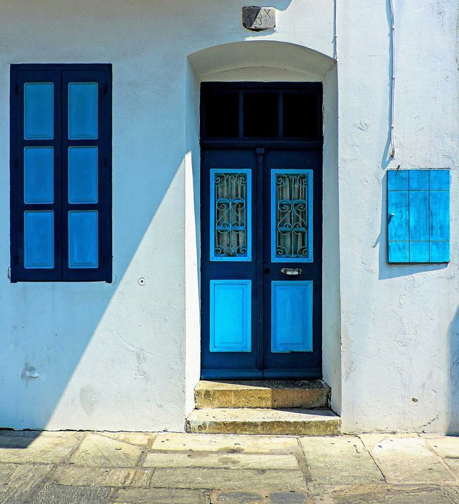 In Greece, it was believed color blue could ward off evil spirits, so that's why you see so many doors and windows painted blue.