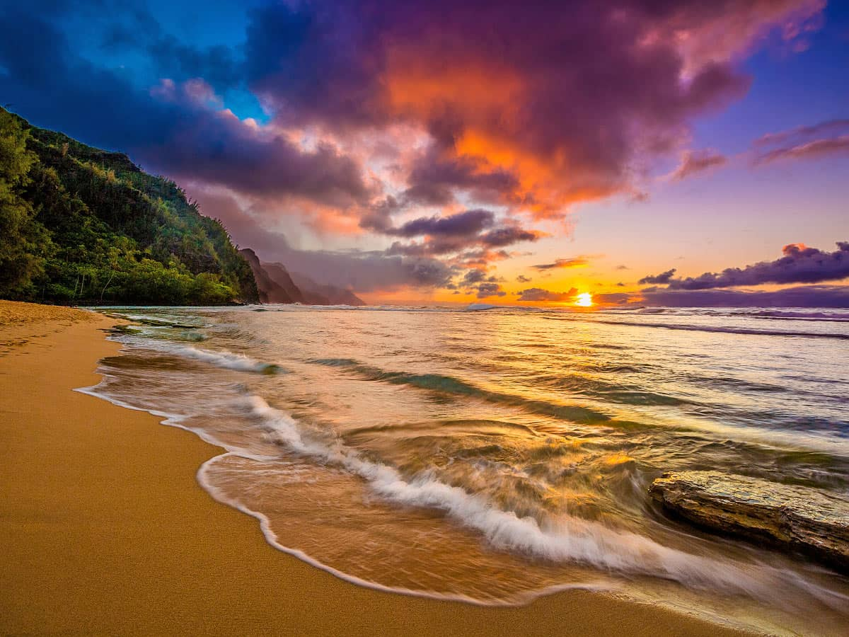 One of the best places to view a spectacular Kauai sunset is Ke'e Beach.