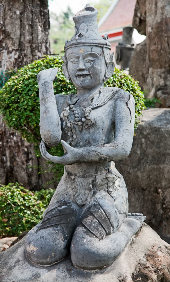 A Thai sculpture of person doing Thai massage
