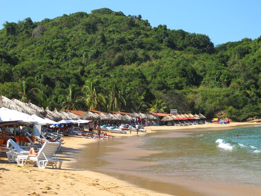 Swimming and relaxing is the name of the game on the calm and sandy side of Ixtapa Island.