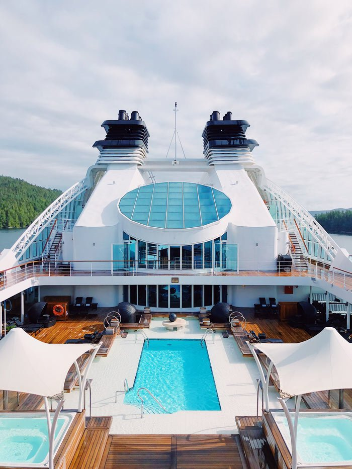 The main pool on Seabourn Odyssey has plenty of loungers on either side, and umbrellas provide shade.