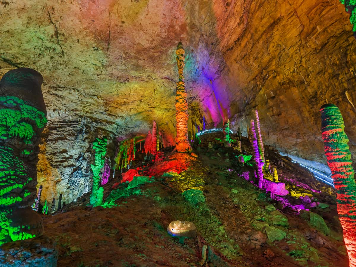 The Yellow Dragon Cave is lit up by colorful lights.