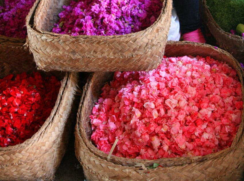 As offerings, small palm-leaf trays are sprinkled with flower petals from big baskets like these.