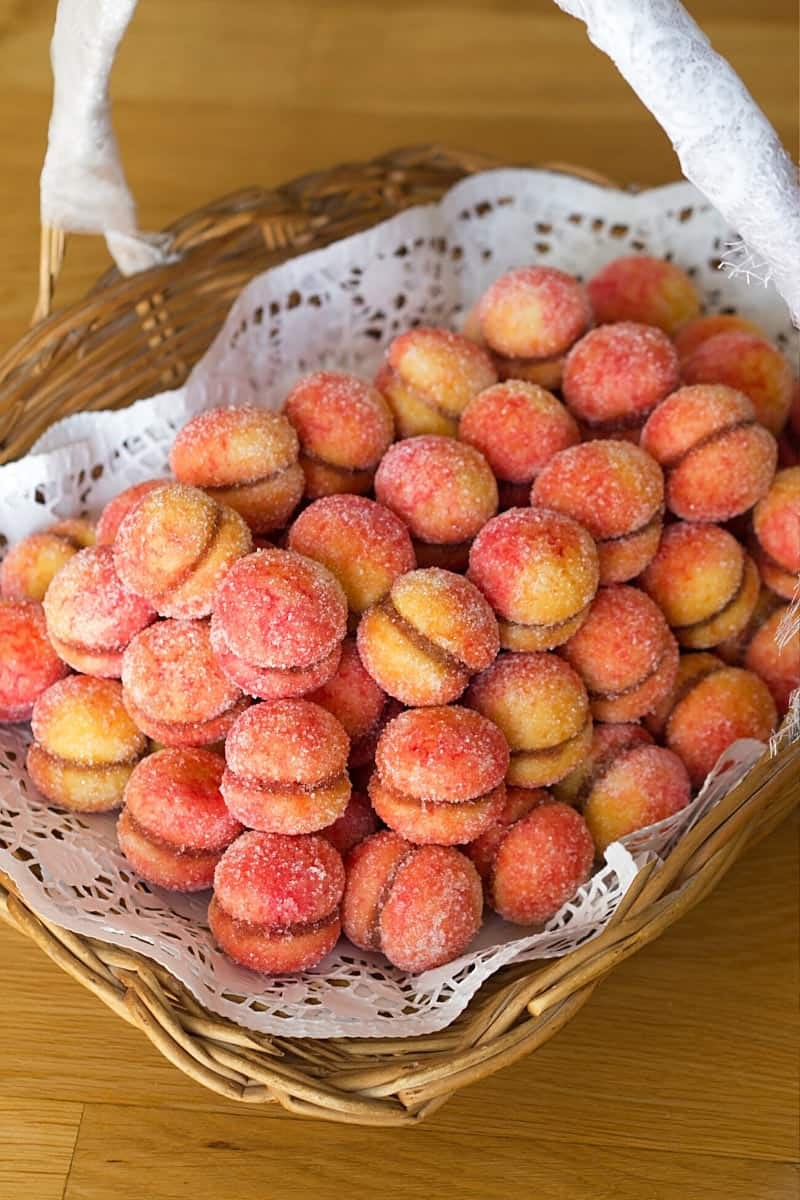 Breskvice are peach-shaped Croatian cookies with peach or apricot jam sandwiched between two layers.