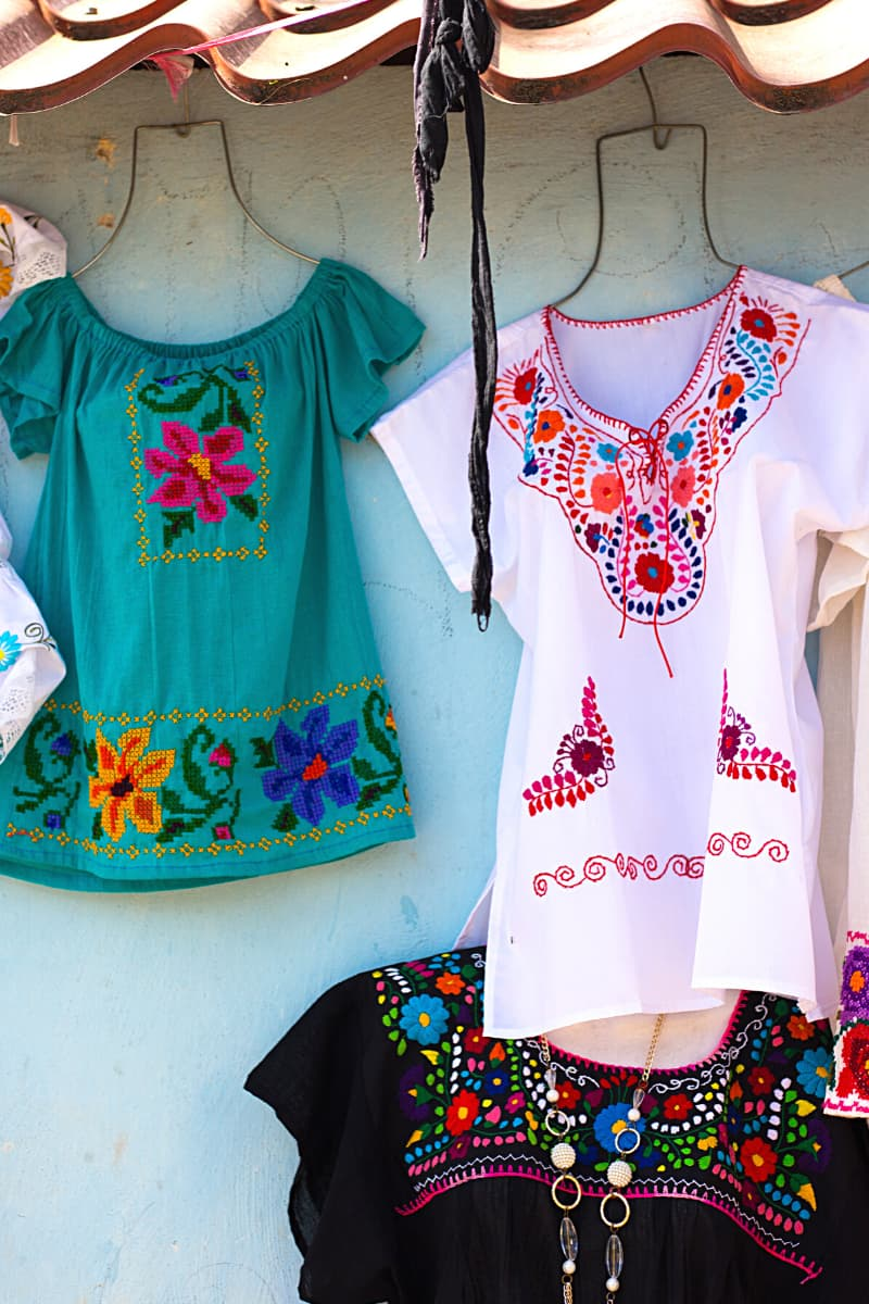 The most traditionally Mexican clothing item a woman can buy as a souvenir from Mexico is the huipil.