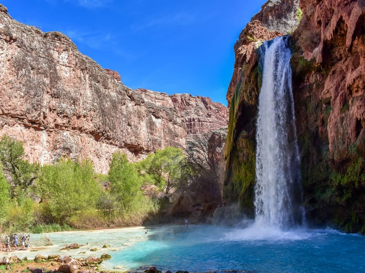 One of the most deliciously cool places to swim after a hot hike in Arizona's Grand Canyon is the pool at the base of Havasu Falls.