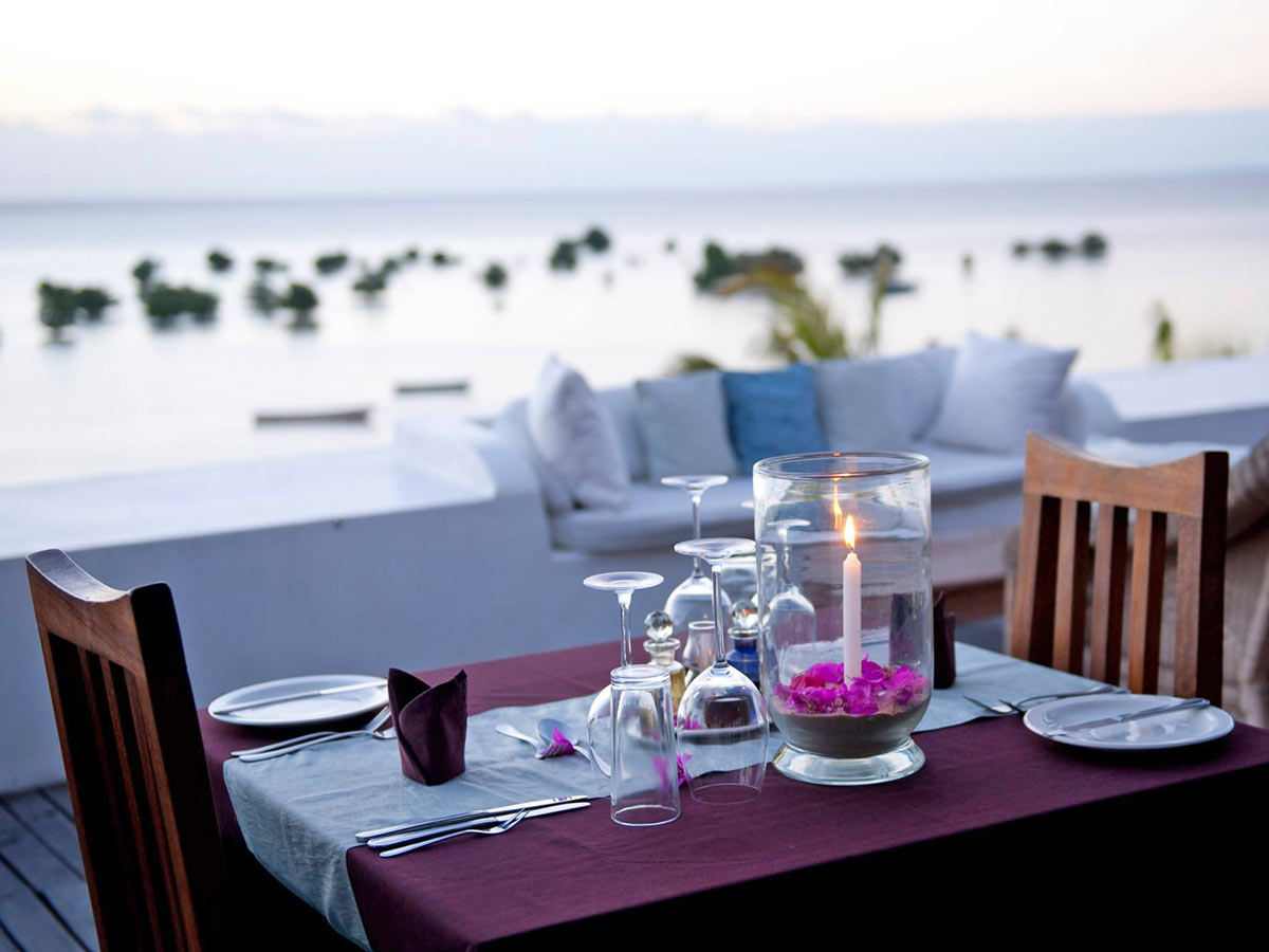 Table set for dinner for two on the rooftop of Ibo Island Lodge, Mozambique