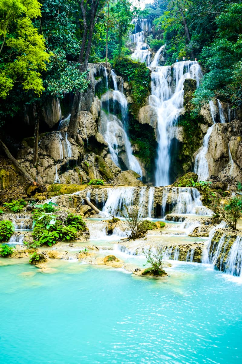 Also known as Tat Kuan Si, the three-tiered Kuang Si Waterfalls in Laos are one of the most beautiful places to swim in the world.