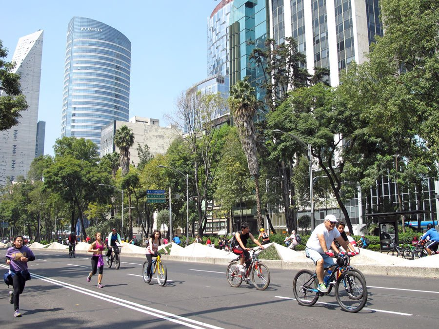 Bicyclists and joggers enjoy the car-free Paseo de la Reforma on Sunday mornings.