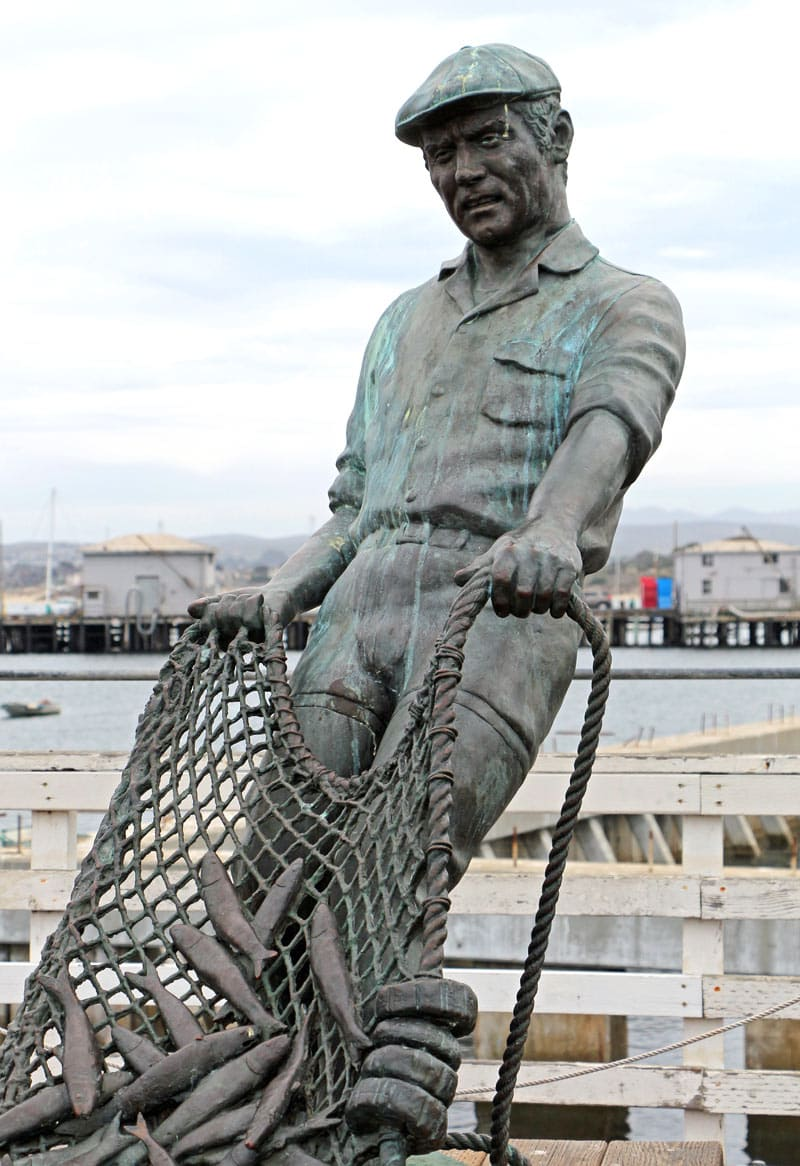 """Statue of the """"The Fisherman"""" by Jesse Corsaut at the Old Fisherman's Wharf in Monterey"""