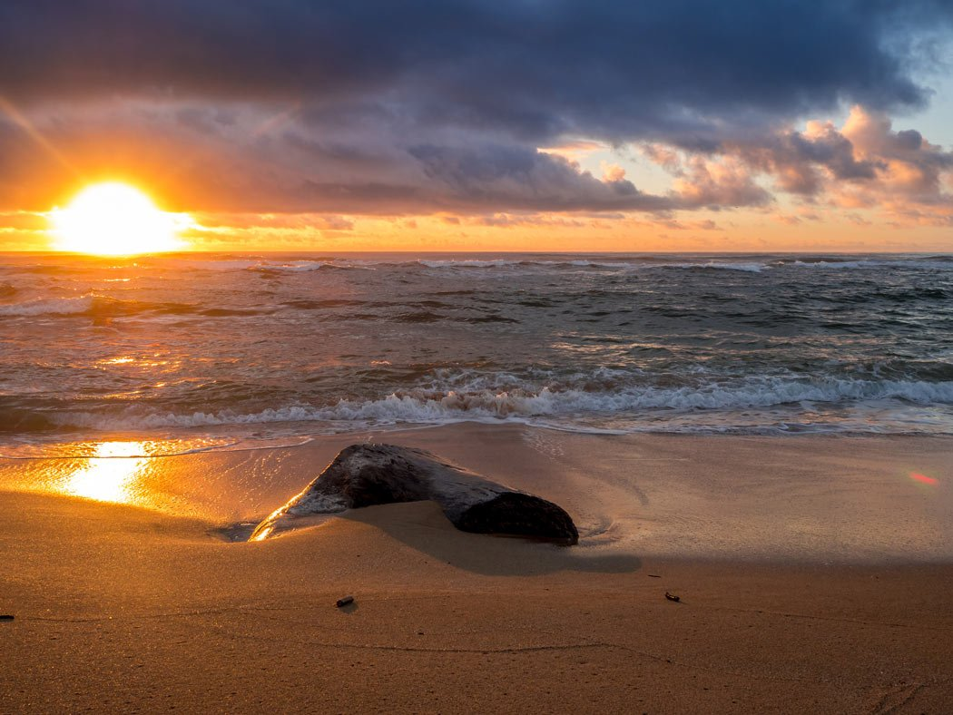 A great place to watch the sunrise in Kauai is Lydgate Beach.