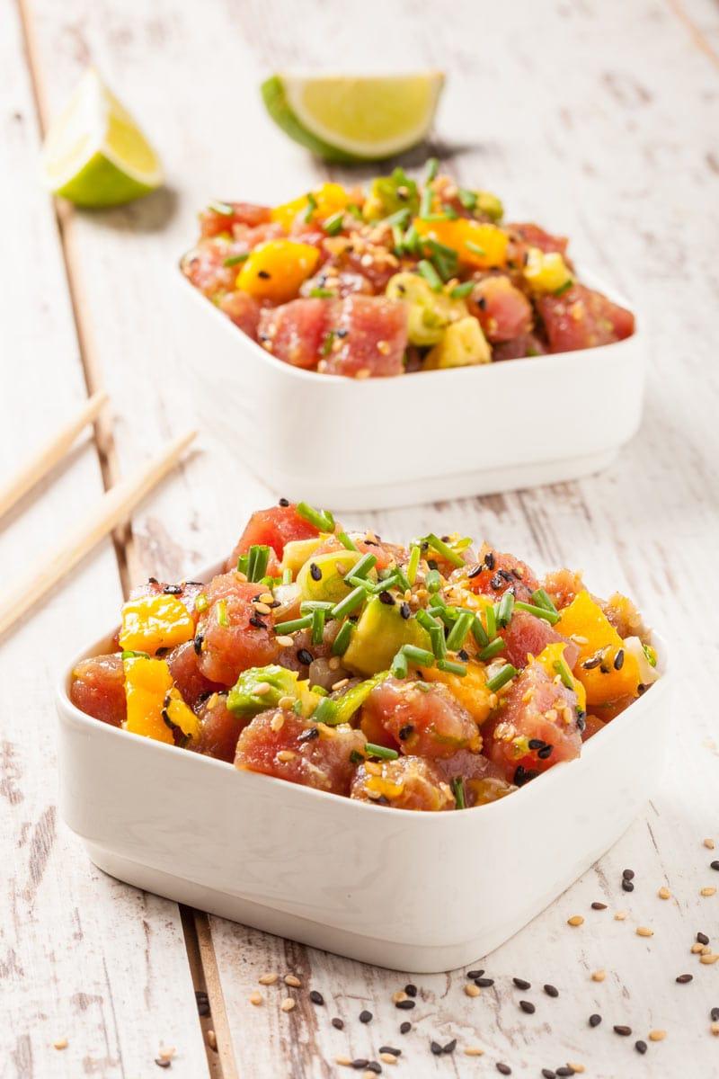 Poke is a Hawaiian dish of diced raw fish, typically marinated and seasoned.