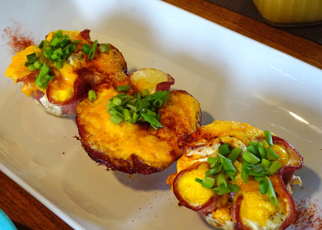"""A cheesy egg-and-bacon """"pie"""" is a good start to a busy day of snorkeling and swimming."""