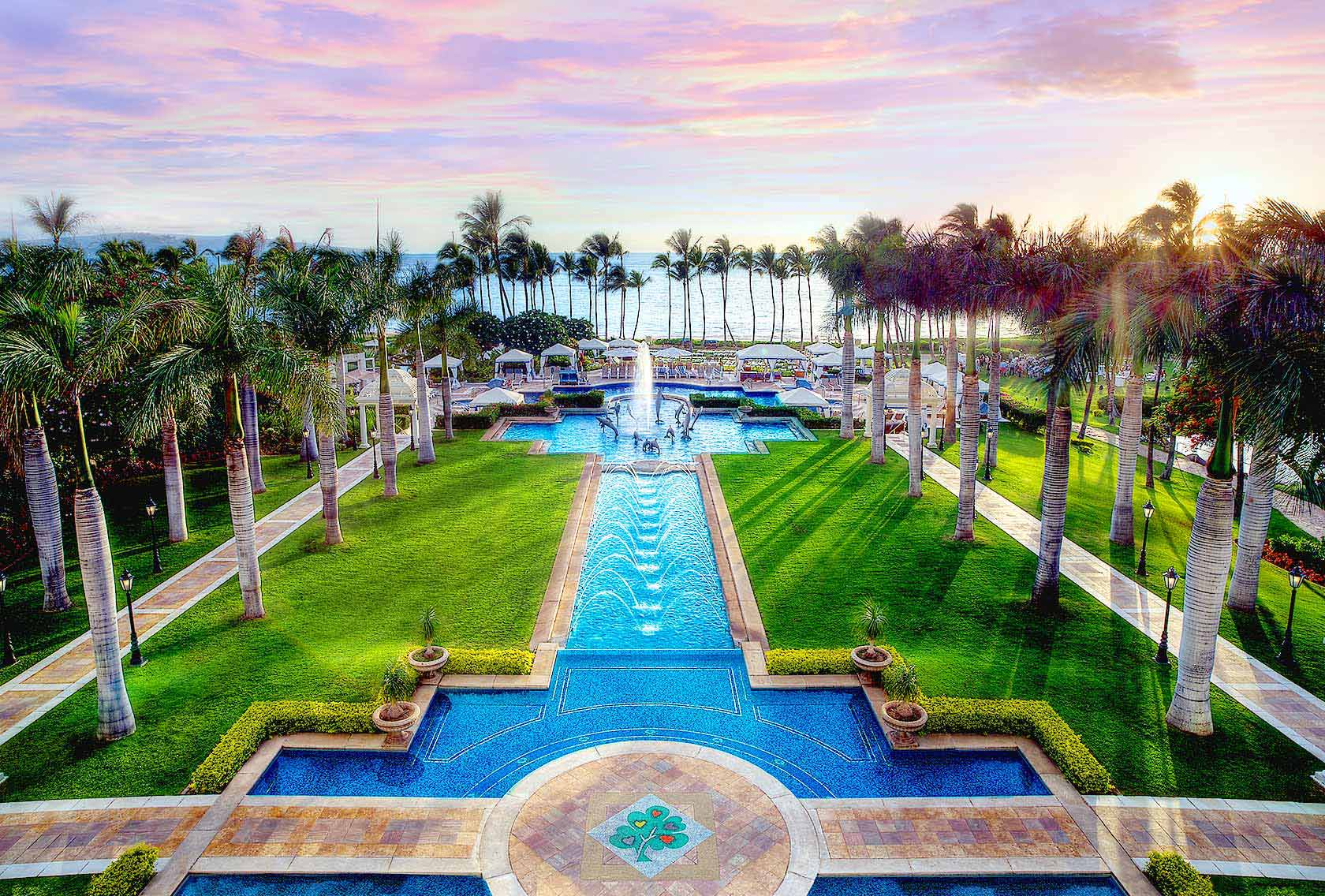 The bottom of the 4,850 sq. ft. adults-only Hibiscus Pool at the Grand Wailea Resort is inlaid with over 630,000 Mexican glass tiles in a hibiscus flower pattern.