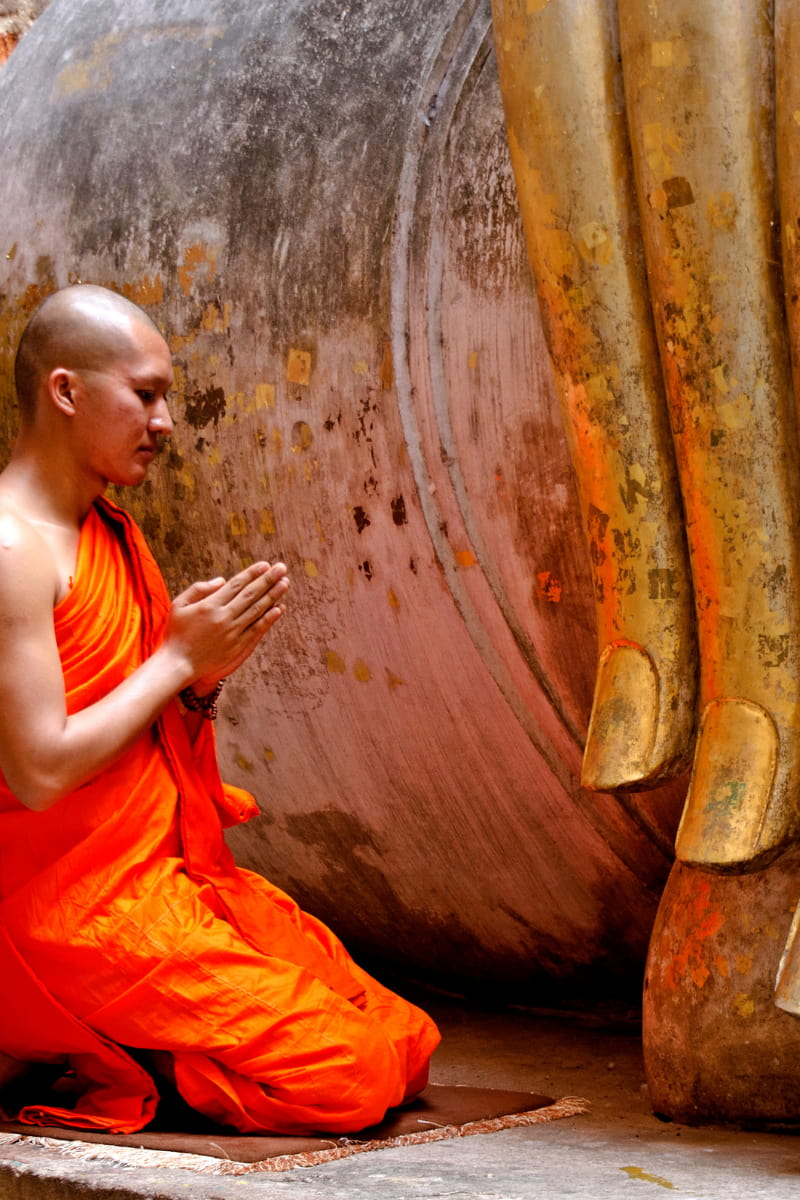 A Buddhist monk at prayer.