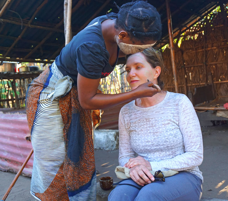 Connecting with locals can often be the most meaningful part of your trip! (Janice gets her face painted here in Mozambique)