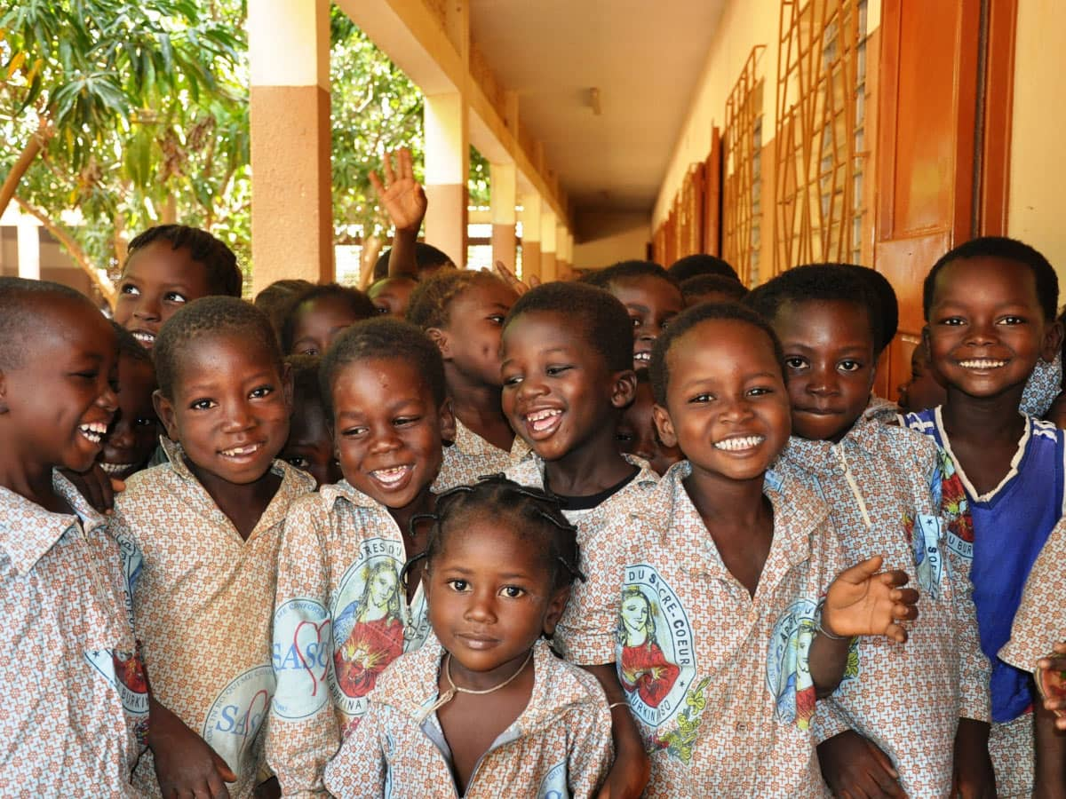 Donating to a school is a responsible way to give back when traveling.