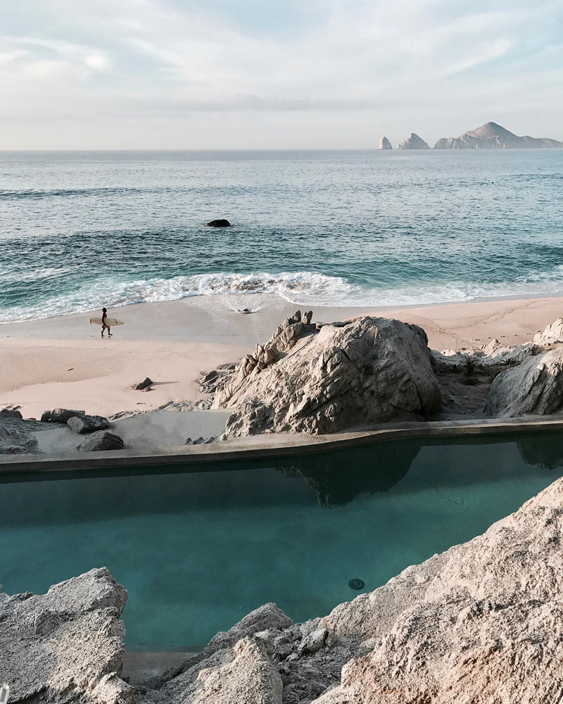 A surfer at Monuments Beach, Los Cabos, searches for swell.