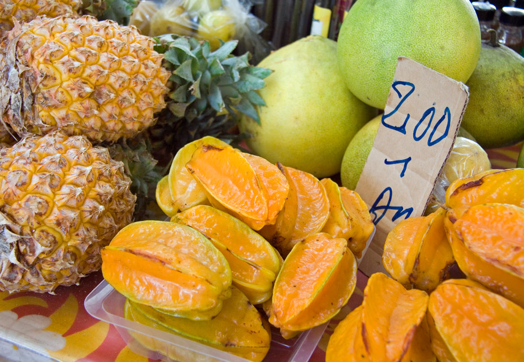 Tropical fruits for sale in a market in Papeete, Tahiti.